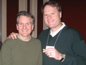 John Burke (right) holds a Detroit Gets Green pin