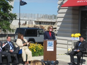 Kathy Wendler of the Southwest Detroit Business Association addresses the ribbon cutting crowd