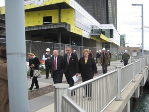 Both Michigan Senators flank the Secretary of Transportation Ray LaHood on the Detroit RiverWalk